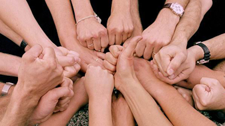 Huddle with hands