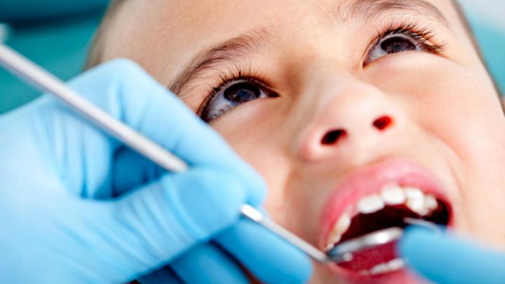 Brown Eyed Child At Dentist