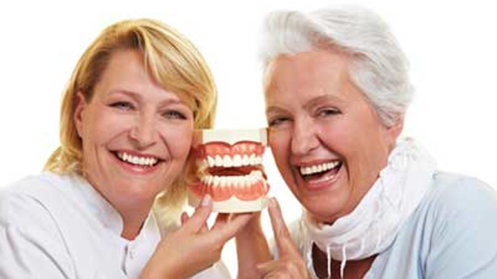 Dentist With Older Patient