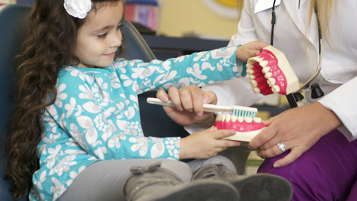 Content Dam Diq En Articles 2014 05 Where Purpose And Practicality Meet The Role Of Dsos In Improving The Oral Health Of Children In America S Underserved Communities Leftcolumn Article Thumbnailimage File